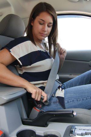 Female driver buckling seatbelt